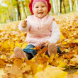 Laughing autumn kid — Stock Photo #5759106