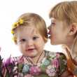 Cute girl whispering something to her sister — Stock Photo