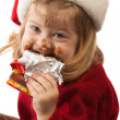 Little gourmet in Santa hat, isolated — Stock Photo