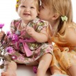 Girl kissing her sister — Stock Photo #5759135