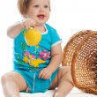 Stock Photo: Child holding a yellow apple