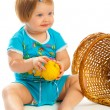 Stock Photo: Baby girl holding apple
