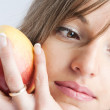 Woman with an apple in hand — Stock Photo #5759395