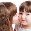 Stock Photo: Girl kissing her sister