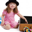 Girl near suitcase — Stock Photo