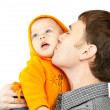 Royalty-Free Stock Photo: Dad kissing daughter