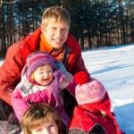 Happy winter family — Stock Photo