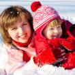 Mother and daughter playing in snow — Stock Photo
