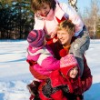 Parents with daughters playing in snow — Stock Photo #5759691