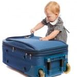 Baby opens suitcase — Stock Photo #5759797