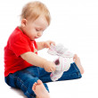 Baby trying on trainers — Stock Photo