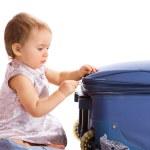 Baby zipping suitcase — Stock Photo #5759868