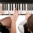 Hands on piano — Stock Photo #5759955