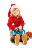 Dívka drží vánoční dárek — Stock fotografie
