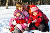 Cheerful winter family — Stock Photo