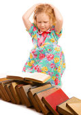 Girl looking at books — Stock Photo