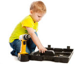 Boy, box and screwdriver — Stock Photo