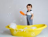 Baby with sponge — Stock Photo