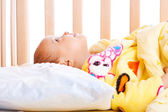 Baby in crib — Stock Photo
