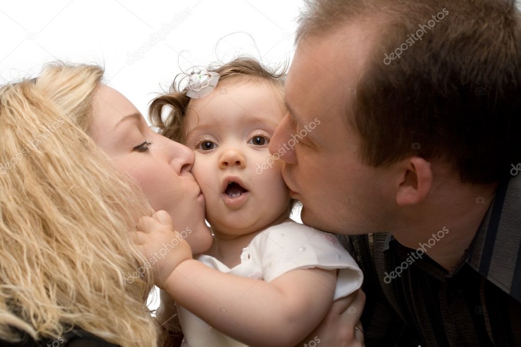 Parents kissing their daughter, isolated, on white background  Stock Photo #5758992