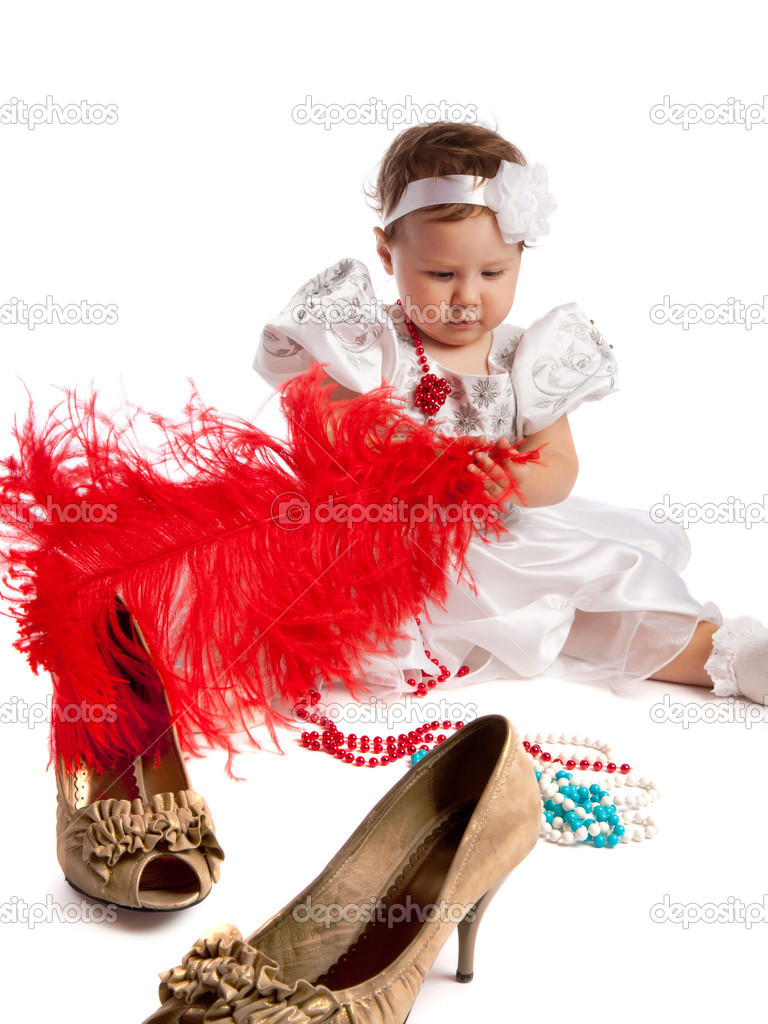 Little girl holding big red feather, female shoes in the foreground, isolated — Stock Photo #5759086