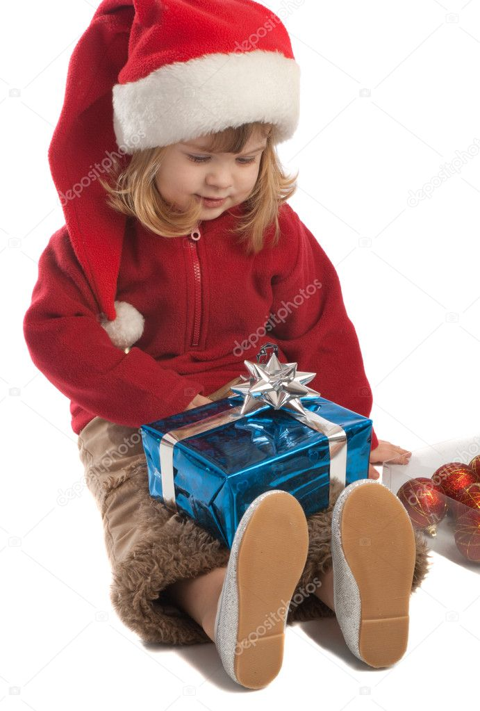 Little Santa helper looking at present box, isolated — Stock Photo #5759125