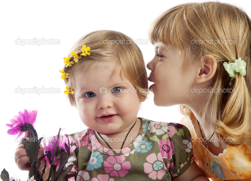 Cute red-haired girl whispering something to her sister, isolated — Stock Photo #5759130