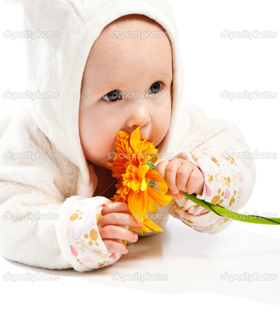 Adorable baby with orange flower — Stock Photo #5759318