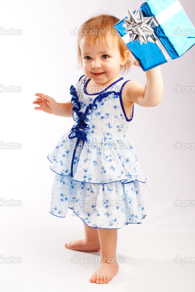 Lovely toddler holding a blue present box — Stock Photo #5759359