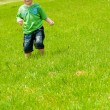 Boy running along the hill — Stock Photo