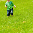 Boy running along the hill - Stock Photo