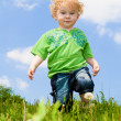Stock Photo: Kid in grass