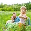 Family in grass — Stock Photo