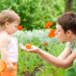 Mom and toddler in garden — Stock Photo