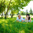 Parents with baby in park — Stock Photo