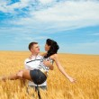 Man and woman in wheat — Stock Photo #5760316