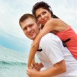 Man and woman on beach — Stock Photo #5760322