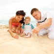 Mother, father and baby on beach — Stock Photo #5760324