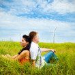Couple having rest in the meadow — Stock Photo