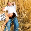 Couple lying in wheat — Stock Photo