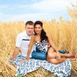 Couple in wheat — Stock Photo