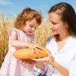 Giving a bread loaf — Stock Photo #5760624