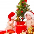 Stock Photo: Babies looking for presents