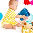 Baby with birthday present — Stock Photo