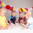 Babies with cupcakes — Stock Photo