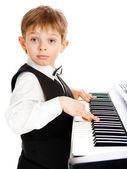 Boy playing piano — Stock Photo