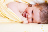 Baby in bed — Stock Photo