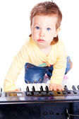 Baby playing piano — Stock Photo