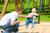 Father and son on the playground — Stock Photo