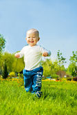 Baby boy running — Stock Photo